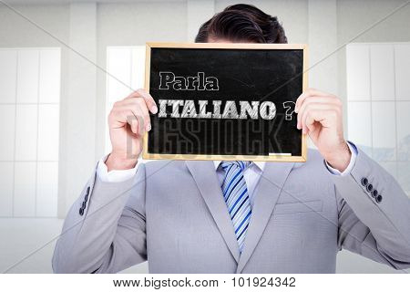 Businessman showing board against room overlooking ocean