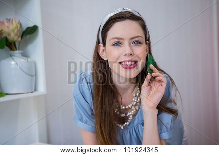 Brunette at till with credit card in fashion boutique