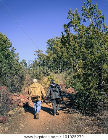 Senior couple is hiking on a trail in Tonto Bridge State Park in Arizona