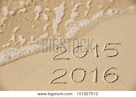 2015 2016 Inscription Written In The Wet Yellow Beach Sand Being Washed With Sea Water Wave