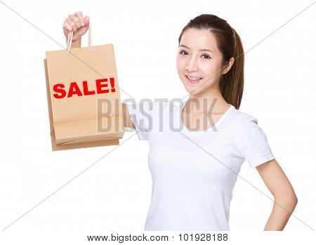 Woman hold with shopping bag and showing a word of sale!