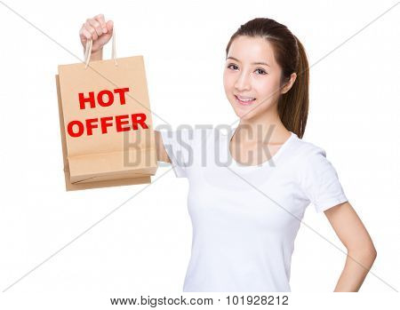 Woman hold with shopping bag and showing phrase of hot offer