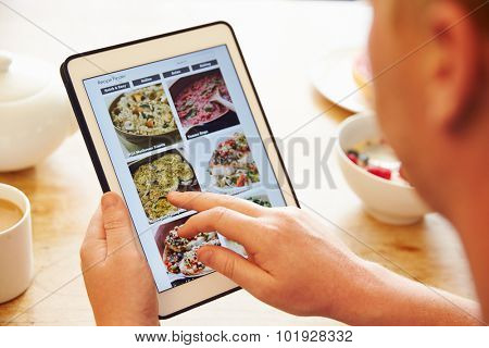 Person At Breakfast Looking At Recipe App On Digital Tablet