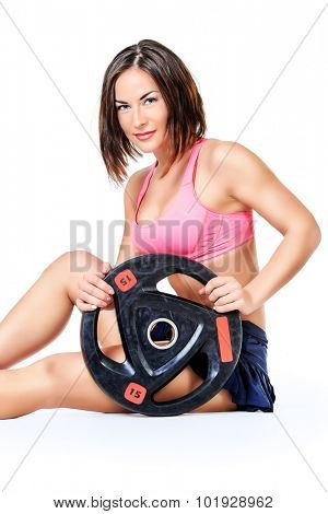 Athletic young woman posing with a barbell plate. Fitness sports. Healthcare, bodycare. Isolated over white.