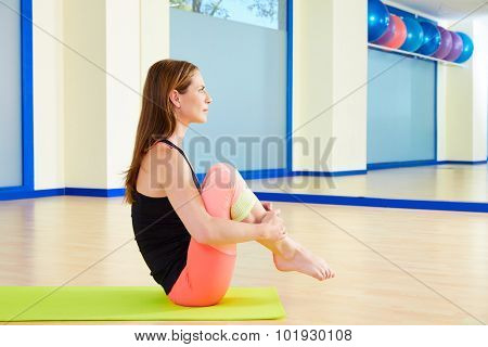 Pilates woman rolling like a ball exercise workout at gym indoor