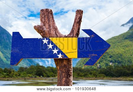 Bosnia and Herzegovina Flag wooden sign with landscape on background