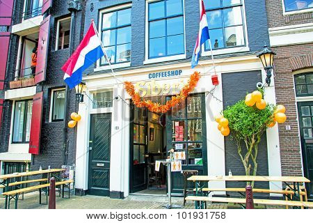 AMSTERDAM APR 27:Kings Day in Amsterdam, decorated dutch coffee shop on April 27. 2015 in the Netherlands