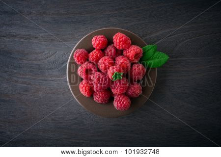 Raspberries  On Rustic Wooden Background Top Wiew