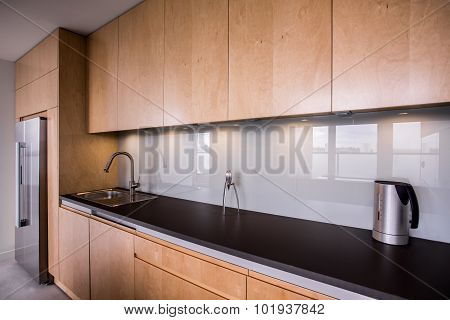 Wooden Cupboards And Black Worktop