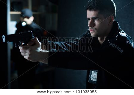 Police Officer With Handgun