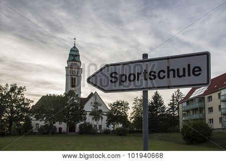 Guidepost To The Sportschule With The St. Bonifatius Church In Werdau, Germany, 2015