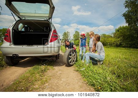 Friendly Family Is On A Picnic. A Car Breakdown.