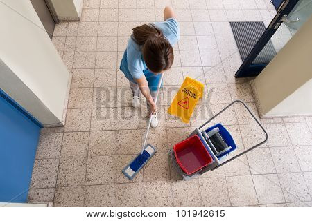 Janitor Mopping Floor With Cleaning Equipments
