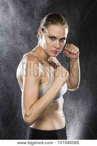 Athletic Woman in Combat Pose with Fierce Look