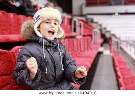 Boy Loudly Shouts On  Hockey Match