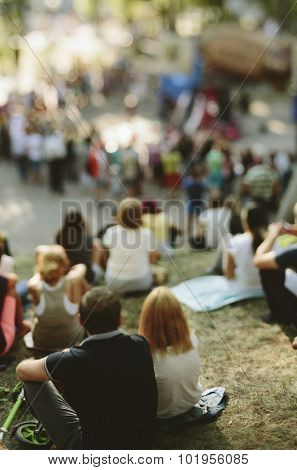Group of  people relaxing, having a picnic ,tilt-shift lens