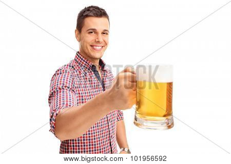 Joyful man holding a large beer mug full of beer and looking at the camera isolated on white background