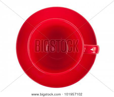Red round empty tea cup on a saucer