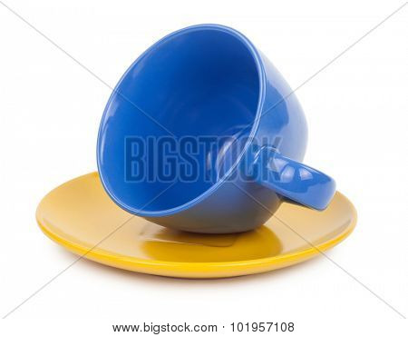 Blue cup of tea on a yellow saucer