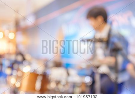 Blurred Photo Of Drummer Playing On Drum Set On Stage In Music Concert.
