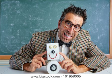 Nerd electronics technician with self made robot silly retro teacher