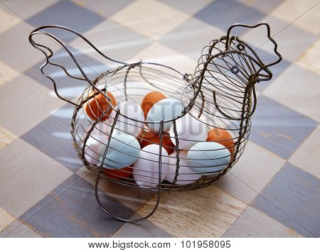 Eggs in a vintage hen shape basket with blue easter white and brown colors