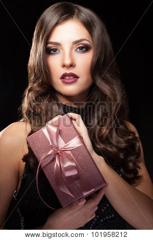 Girl Holding Gift Box In Hands On Black Background
