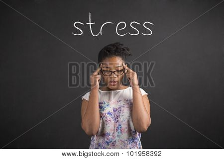 African Woman With Fingers On Temples Thinking About Stress On Blackboard Background