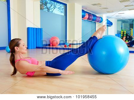 Pilates woman hundred fitball exercise workout at gym indoor swiss ball