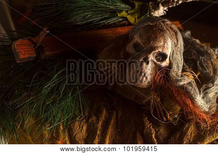 Halloween concept of scary skull head on the ground