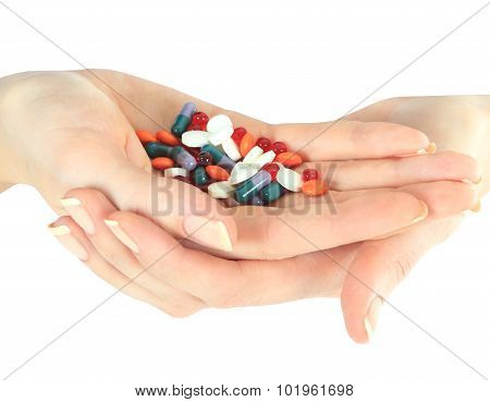 Stack of different pills in woman hands