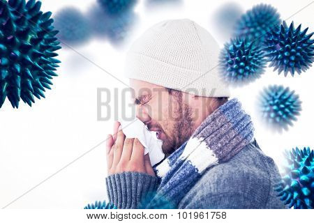 Handsome man in winter fashion blowing his nose against virus