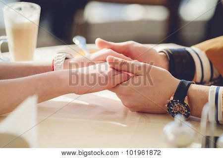 Concept of male and female hands love and coffee.
