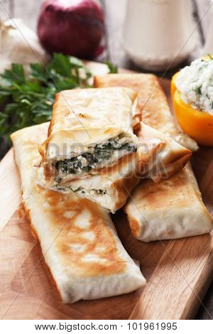 Borek or pita, filo pastry with cheese and spinach filling