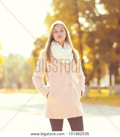 Fashion Pretty Woman Wearing A Pink Coat In Sunny Autumn Park