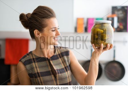 Closeup Of Woman Holding Up Big Jar Of Freshly-made Dill Pickles