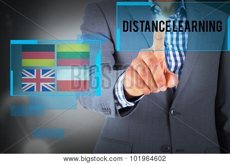The word distance learning and focused businessman pointing against grey background