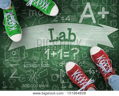 The word lab and casual shoes against green chalkboard