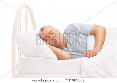 Calm senior man sleeping in a bed covered with a white blanket isolated on white background