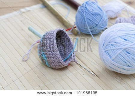 Color woolen clews for knitting and crochet woven piece close-up, selective focus
