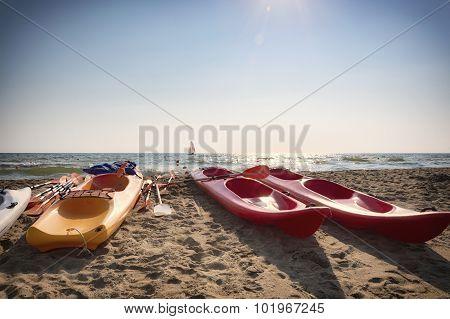 Colorful Kayak And Sailboat