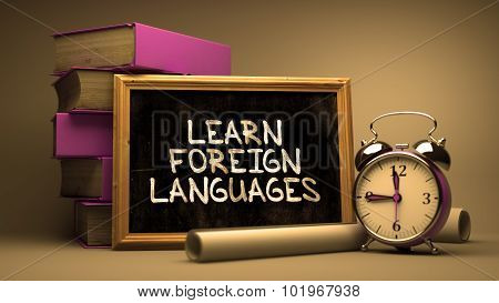 Learn Foreign Languages Handwritten on Chalkboard.