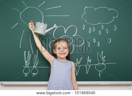 girl with watering can drawing rain on school board