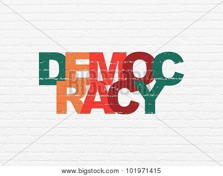 Politics concept: Democracy on wall background