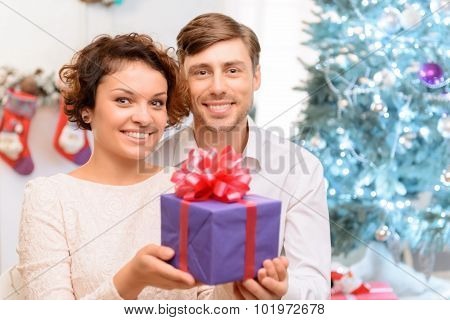 Loving couple holding present