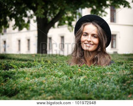 happy young woman in a park