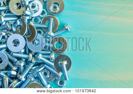 Bolts And Nuts On Wooden Background