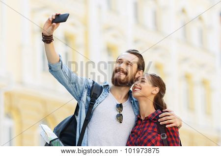 Happy tourists making selfie