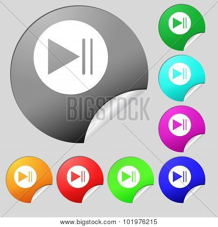 Play Button Icon. Set Of Eight Multi Colored Round Buttons, Stickers. Vector