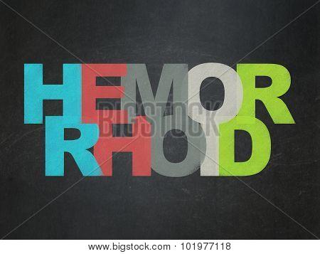 Health concept: Hemorrhoid on School Board background
